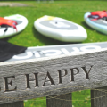 Be happy written on a bench