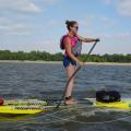 Anna Lundberg paddleboarding on the Mississippi
