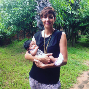Cecile holding a baby