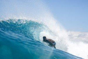 Kahi Pacarro surfing