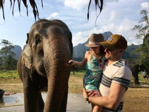 Thomas with his daughter and an elephant
